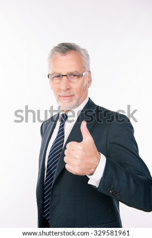 confident intelligent  businessman showing thumb up