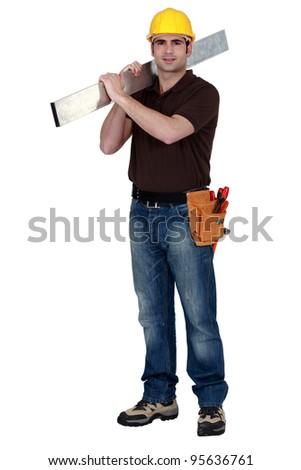 Confident laborer on white background - stock photo