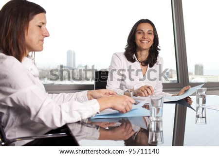 confident latin businesswoman smiling in office