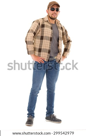confident latin man in flannel shirt cap and sunglasses standing fullbody isolated on white