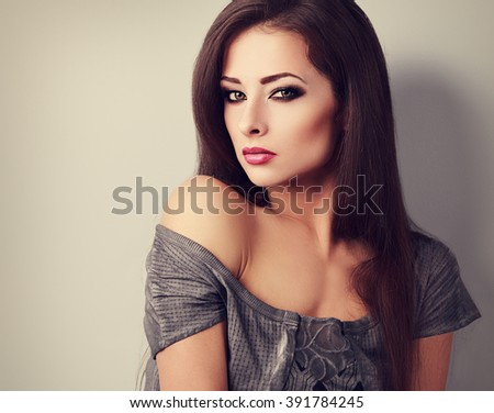 Confident makeup woman with long smooth hair style looking. Toned closeup portrait