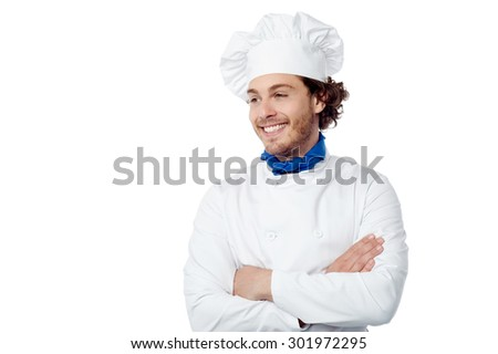 Confident male chef looking at copy space - stock photo