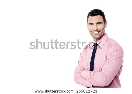 Confident male executive posing with crossed arms - stock photo