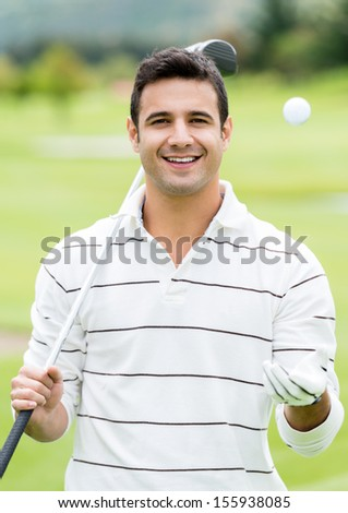 Confident male golf player looking very happy - stock photo