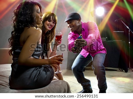confident man flirting with women to get a phone number - stock photo