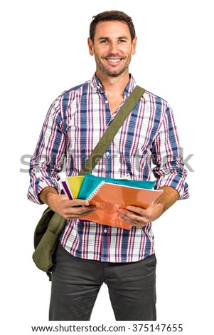 Confident man holding notepads on white screen - stock photo