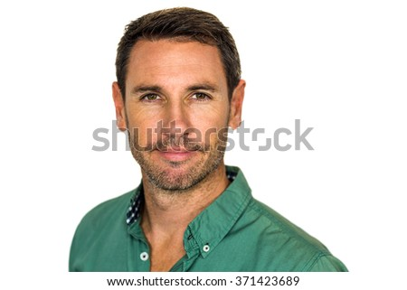Confident man looking at camera on white screen - stock photo