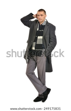 Confident man posing in coat on a white background - stock photo