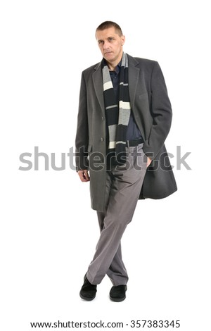 Confident man posing in coat on a white background