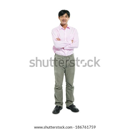 Confident Man Standing with Arms Crossed - stock photo