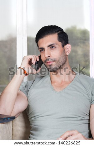 confident man talking on the mobile phone, - stock photo