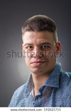 Confident man wearing blue shirt
