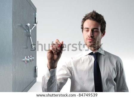 confident man writing and 3d safe box - stock photo