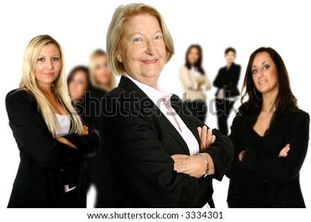 Confident mature female caucasian businesswoman leading a diverse team of female colleagues in the background. Concept of diversity in teamwork. - stock photo