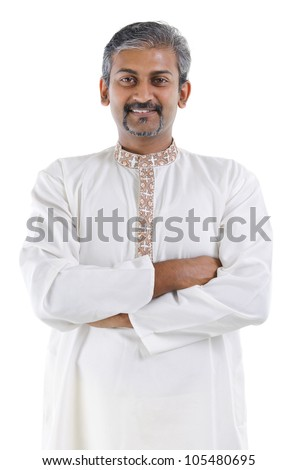 Confident mature traditional Indian man in kurta dhoti crossed arms isolated on white background - stock photo
