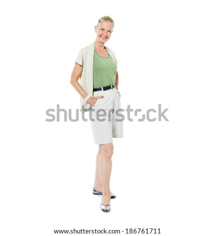 Confident Mature Woman Standing and Smiling - stock photo
