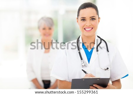 confident medical doctor portrait in hospital - stock photo