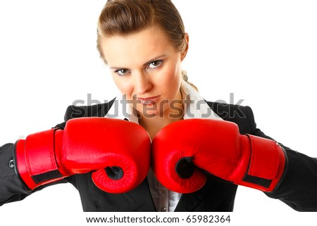 Confident modern business woman with boxing gloves isolated on white - stock photo