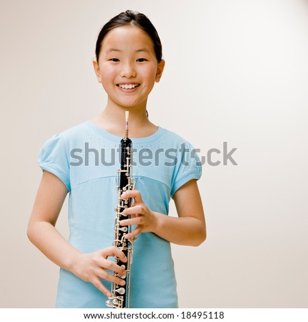 Confident musician holding clarinet