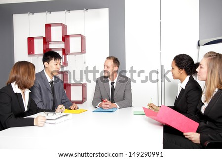 Confident partners sharing new ideas at meeting in conference room - stock photo
