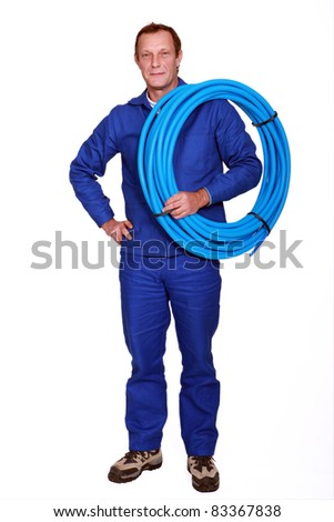 Confident plumber, studio shot - stock photo