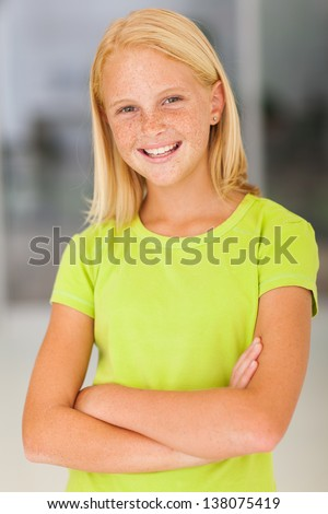 confident preteen girl portrait with arms crossed - stock photo