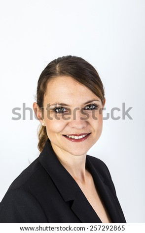 Confident pretty woman standing with space for copy - stock photo
