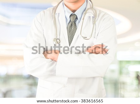 confident professional male doctor with modern hospital background