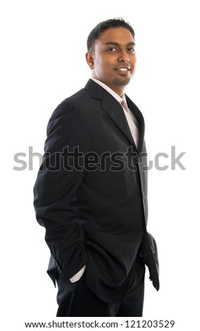 Confident 30s Indian businessman standing isolated on white - stock photo