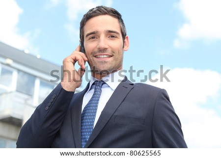 Confident salesman stood outside