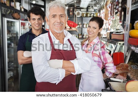 Confident Salespeople In Cheese Shop - stock photo