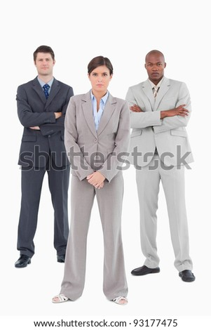 Confident salesteam standing together against a white background