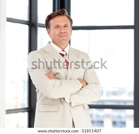 Confident senior business manager looking at the camera - stock photo