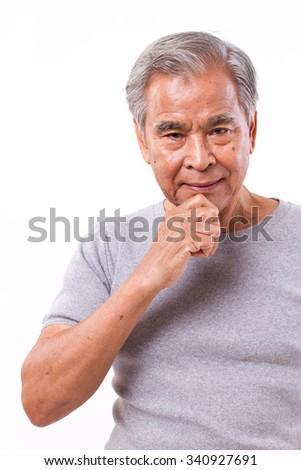 confident senior man thinking - stock photo