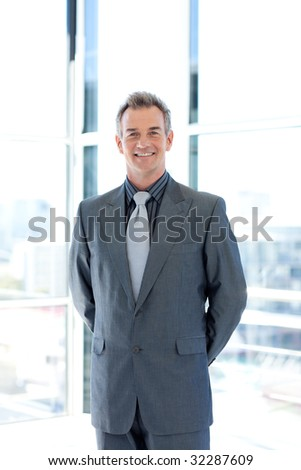 Confident senior manager standing in office - stock photo