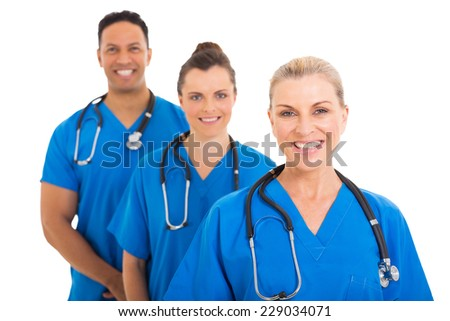 confident senior medical doctor and colleagues - stock photo