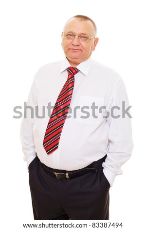 Confident serious middle aged businessman with glasses in white shirt and striped tie standing alone with his hands in pockets. Mask included - stock photo