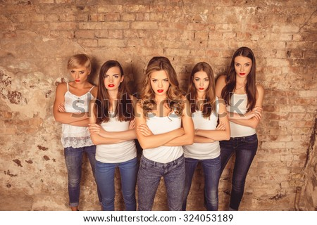 Confident serious young women with red lips