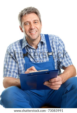 Confident service man taking notes - stock photo