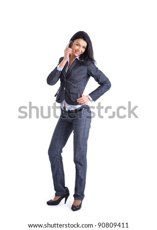Confident smart businesswoman on mobile phone call - stock photo