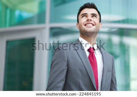 Confident smiling business man outdoor - stock photo
