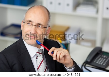 confident smiling businessman looking at the side - stock photo