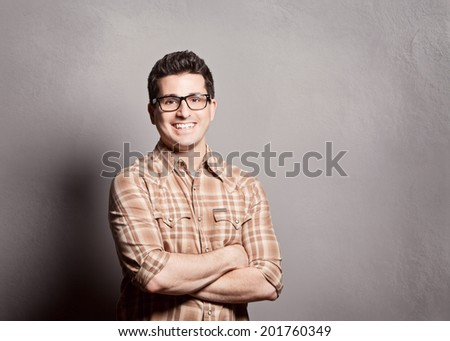 Confident smiling happy young man  - stock photo