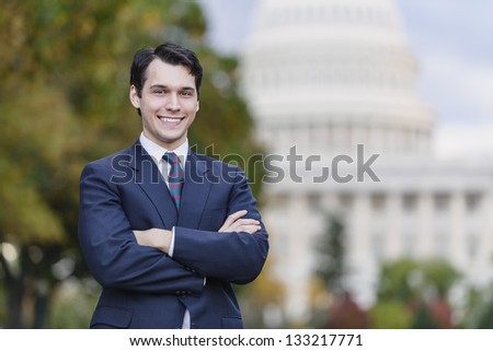 Confident Smiling Man Standing In Front Of US Capitol - stock photo
