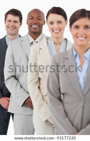 Confident smiling salesteam standing together against a white background