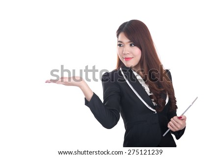confident , smiling smart business woman pointing or presenting on white space