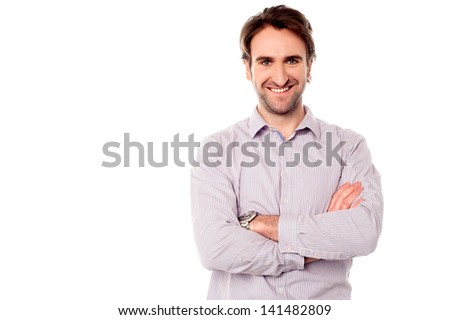 Confident smiling young male posing with arms crossed