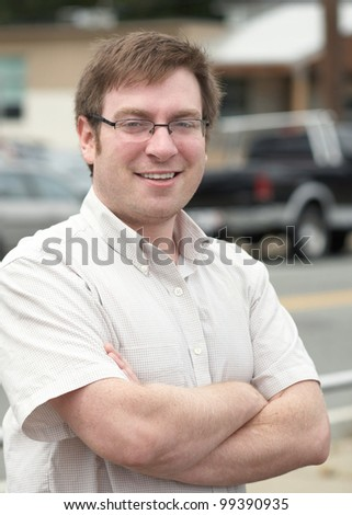 Confident smiling young man outdoor portrait - stock photo
