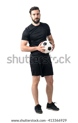Confident soccer of futsal player holding ball with daring look at the camera. Full body length portrait isolated over white background.  - stock photo