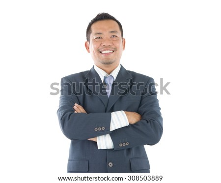 Confident Southeast Asian businessman crossed arms over white background - stock photo